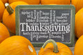 Thanksgiving celebration word cloud of words related to of day on a slate blackboard surrounded by pumpkins Stock Photography