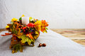 Thanksgiving centerpiece with decorated candle and silk fall lea Royalty Free Stock Photo