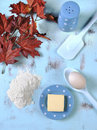 Thanksgiving cooking and baking concept vertical with eggs flour sugar butter with utensils autumn fall leaves on aqua blue shabby Royalty Free Stock Photo