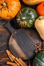 Thanksgiving day or autumn pumpkin holiday background. Dark Wooden background. Top view Royalty Free Stock Photo