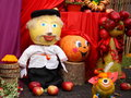 Thanksgiving day stock photos picture puppet man leaves vegetables pumpkins berries apples Stock Images