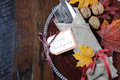 Thanksgiving dining table place setting in traditional rustic country style with copy space. Royalty Free Stock Photo
