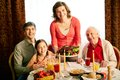 Thanksgiving evening portrait of happy family looking at camera on holiday Royalty Free Stock Photography