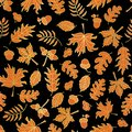 Thanksgiving Gold foil autumn leaves seamless vector background. Golden and orange abstract fall leaf shapes on black background.
