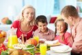 Thanksgiving joy portrait of happy family gathered at festive table on day Stock Image