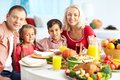 Thanksgiving mood portrait of happy family gathered at festive table on day Royalty Free Stock Photos