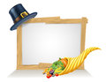 Thanksgiving pilgrim hat cornucopia sign and golden horn of plenty full of vegetables and fruit produce with a or puritan Royalty Free Stock Images