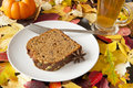 Thanksgiving pumpkin bread tea breakfast of and spice with fall leaves Stock Photo