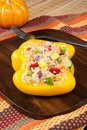 Thanksgiving quinoa stuffed yellow pepper salad in a bell Stock Images