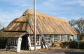 Thatch roof being renewed on an old building Stock Photos