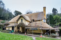 Thatch roof repair a thatched cottage undergoing repairs Royalty Free Stock Photography