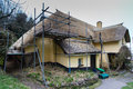 Thatch roof repair a thatched cottage undergoing repairs Royalty Free Stock Images