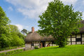 Thatched cottage view of the old rural in spring Royalty Free Stock Photography