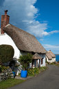 Thatched cottages at church cove on the lizard peninsula in cornwall Stock Photos