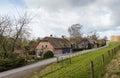 Thatched Farm Houses Along A D...