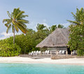 Thatched lounge bar on the beach of maldives Stock Images
