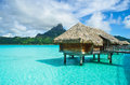 Thatched roof honeymoon bungalow on Bora Bora Royalty Free Stock Photo