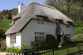 Thatched white cottage Royalty Free Stock Image
