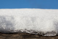 Thawing snow on roof macro of snowmelt shelter sunny day Stock Photography