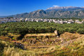 Theater of ancient sparta greece remains ruins there are the modern city and fragment the taygetus massif mt taygetos Royalty Free Stock Images