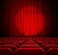 Theater or cinema red curtains with spotlight and seats