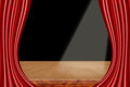 A theater stage with red curtains and spotlight Royalty Free Stock Photo