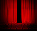 Theatre red curtain open with seats slightly Royalty Free Stock Image
