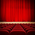 Theatre red curtain on stage with red velvet seats Royalty Free Stock Photo