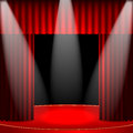Theatrical background scene and red curtains interior for the theater and cinema scene illuminated floodlights Royalty Free Stock Photo