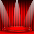 Theatrical background scene and red curtains scene illuminated floodlights red podium on a of red drape curtains Stock Photos