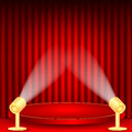 Theatrical background scene and red curtains scene illuminated floodlights red podium on a of red drape curtains Royalty Free Stock Image