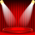 Theatrical background scene and red curtains scene illuminated floodlights red podium on a of red drape curtains Royalty Free Stock Photos