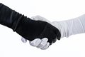Theatrical costumed handshake fancy black and white gloves isolated Royalty Free Stock Images