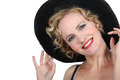 Theatrical woman in a hat Stock Images