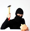 Theft a breaking a piggy bank with hammer isolated on white background Stock Images