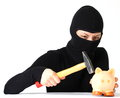 Theft a breaking a piggy bank with hammer isolated on white background Royalty Free Stock Photography