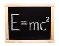 Theory of relativity e mc handwritten with white chalk on a blackboard Royalty Free Stock Photos