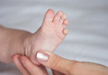 Therapeutic massage for a baby s feet the Stock Image