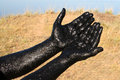 Therapeutic mud hands covered with salt lake in the altai region Royalty Free Stock Photo