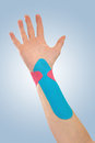 Therapeutic treatment of wrist with tex tape. Stock Photos