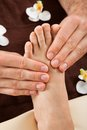 Therapist giving foot massage to female customer at spa closeup of male beauty Royalty Free Stock Photo