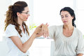 Therapist holding her patients arm Royalty Free Stock Photo