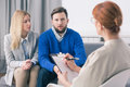 Therapy gives you the opportunity to organize conjugal affection during marital husband talks about problems with his wife Royalty Free Stock Photography
