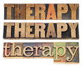 Therapy word in wood type isolated text letterpress three layouts Royalty Free Stock Images