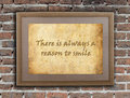 There is always a reason to smile old wooden frame with written text on an old wall Royalty Free Stock Image
