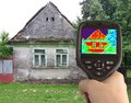 Thermal image of the old house heat loss detection with infrared camera Royalty Free Stock Photography