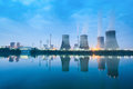 Thermal power plant in nightfall cooling towers and reflection the river Stock Photo