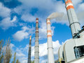 Thermal power plant photo smoking chimneys against the sky and clouds Royalty Free Stock Photography