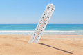 A thermometer on the beach near sea to check temperature Royalty Free Stock Image