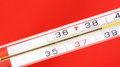 Thermometer close up on a red background Stock Images